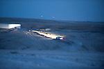 ISRAEL Wadi el-Na'am, Negev desert<br /> A car makes its way after dusk.