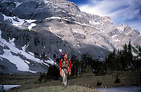 CANADA, ALBERTA, KANANASKIS, MAY 2002. A hiker walks near the Paradise pass.  The Kananaskis Country provincial park is home to Canada's most beautiful nature and wildlife. It has also escaped the mass tourism as in Banff National Park. Photo by Frits Meyst/Adventure4ever.com