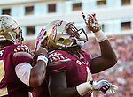 Florida State quarterback Deondre Francois pats running back Dalvin Cook (4) as he  celebrate a touchdown against North Carolina in the second half of an NCAA college football game in Tallahassee, Fla., Saturday, Oct. 1, 2016. North Carolina defeated Florida State 37-35 on a field goal. (AP Photo/Mark Wallheiser)
