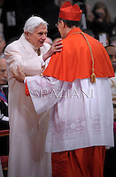 Italian cardinal Beniamino Stella  is congratulated by Pope emeritus Benedict XVI  after he was appointed cardinal by the Pope at the consistory in the St. Peter's Basilica at the Vatican on February 22, 2014.