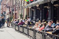 Busy al fresco dining at sidewalk cafes on Sixth Avenue in the New York neighborhood of the Greenwich Village on Saturday, March 22, 2014. (©Richard B. Levine)