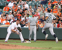 Ichiro Suzuki #51 of the Seattle Mariners tries to get past Ty Wigginton #23 of the Baltimore Orioles at first base during a MLB game at Camden Yards, on August 8 2010, in Baltimore, Maryland. Orioles won 5-4 in extra innings.