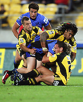 Tyson Keats, Ma'a Nonu and Aaron cruden combine to bring down Drew Mitchell during the Super 14 rugby match between the Hurricanes and Western Force at Westpac Stadium, Wellington, New Zealand on Saturday, 20 February 2010. Photo: Dave Lintott / lintottphoto.co.nz