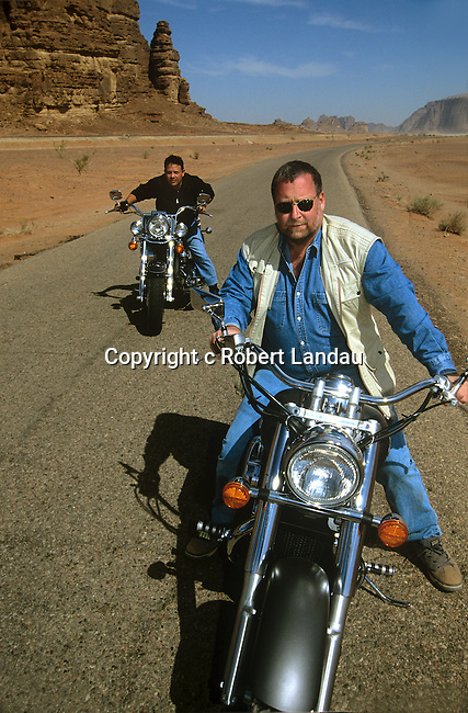 Peter Greenberg and King Abdullah II of Jordan riding motorcycles in Wadi Rum during filming of The Royal Tour