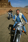 Peter Greenberg and King Abdullah II of Jordan riding motorcycles in Wadi Rum during filming of The Royal Tour