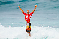 Kelly Slater (USA). SOMEWHERE, Porta Del Sol/Puerto Rico (Saturday, November 6, 2010) -Kelly Slater (USA), 38, has made sporting history today, claiming an unprecedented 10th ASP World Title at Rip Curl Pro Search Puerto Rico.. .With his advancement out of the Quarterfinals of the Rip Curl Pro Search Puerto Rico over Adriano de Souza (BRA), 23, Slater amassed enough points to move out of reach remaining contender Jordy Smith (ZAF), 22, and collect the 2010 ASP World Title, culminating a 20-year effort..Kelly Slater (USA), 38, newly-crowned 10-time ASP World Champion, has claimed his 45th elite tour event, taking down the Rip Curl Pro Search Puerto Rico over Bede Durbidge (AUS), 27, in pumping three-to-four foot (1.5 metre) waves in Porta Del Sol.. .Event No. 9 of 10 on the 2010 ASP World Tour, the Rip Curl Pro Search Puerto Rico has been an event of extremes.. .Last Tuesday, the international sporting world was dealt a devastating blow with the tragic and unexpected loss of former three-time ASP World Champion and current ASP World Tour competitor Andy Irons (HAW), 32.. .After a somber two-day postponement of the event out of respect for Irons's passing, the world's best surfers roared back to life for two of the most high-performance days in surfing history.. .Today, Slater clinched his historic and unprecedented 10th ASP World Title before going on to take out the Rip Curl Pro Search Puerto Rico, as comprehensive and dominant a performance as the sporting world has ever bore witness to..Photo: joliphotos.com
