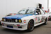 A BMW M3 parked under team tent at Circuit Mont-Tremblant for the Fall Classic race