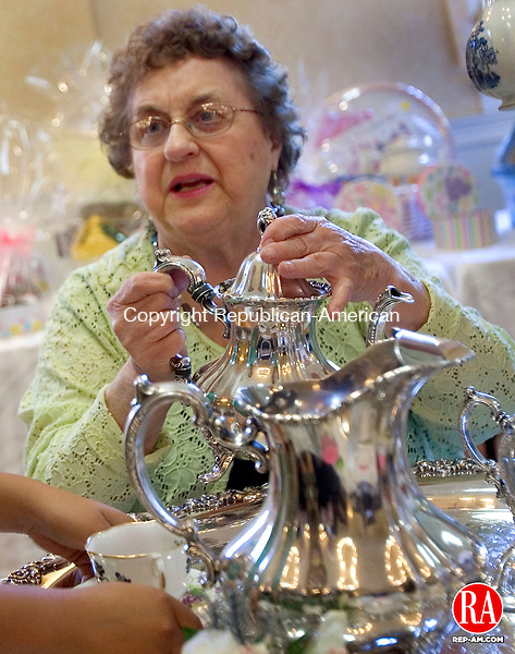 WOLCOTT CT. 05 May 2013-050513S07-Fran Kramarz of Wolcott pours tea during a Mother's Day tea, with scones, pastries, finger sandwiches and flowers, at St. Pius X Church in Wolcott Sunday..Steven Valenti Republican-American