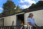Lorie Collins stands on her front porch in Jackson, Kentucky. October 14, 2011. Photo by Melanie Hobgood