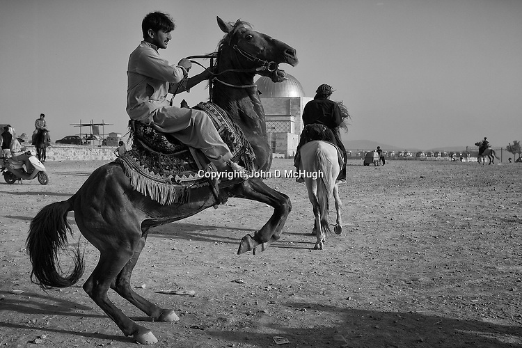 Horseriders are seen at King Zahir Shah's Tomb in Kabul, 24 August 2012. (John D McHugh)