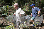 Hugh & Kevin Carrying Traps Into Field