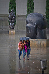 "Women walk among the sculptures in the sculpture park of the painter and sculptor Fernando Botero, who supervises the assembly of historical work  ""Via Crucis, Passion of the Christ "" at the Museum of Antioquia in Medellin, Colombia. 01/04/2012. Photo by Fredy Amariles / VIEWpress."