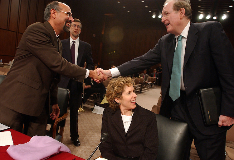 Sen. John Rockefeller, D-W.V., greets Gregory Nojeim of the Washington Legislative Office, left, James Dempsey of the Center for Democracy and Technology, center, and Heather Mac Donald of the Manhattan Institute, before a hearing of the Senate Committee on Intelligence onthe reauthorization of the Patriot Act.