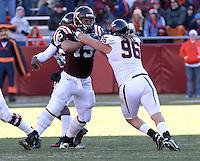 Nov 27, 2010; Charlottesville, VA, USA;  Virginia Tech Hokies guard Greg Nosal (75) blocks Virginia Cavaliers defensive tackle Nick Jenkins (96) during the game at Lane Stadium. Virginia Tech won 37-7. Mandatory Credit: Andrew Shurtleff