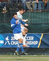 Creighton University midfielder Timo Pitter (18) and University of Connecticut defender Flo Liu (16) battle for head ball. .NCAA Tournament. Creighton University (blue) defeated University of Connecticut (white), 1-0, at Morrone Stadium at University of Connecticut on December 2, 2012.