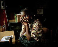 """32 year old Monique from DR Congo at a friend's flat in North London. She had completed three years of a four year course in electrical engineering at a university in Kinshasa when she decided to attend a student demonstration opposing the government. To her horror, she witnessed the murder of her friends by government forces who wanted to put an end to the demonstration. Until then she had led a comfortable life, her father was a doctor and her family placed a great deal of emphasis on education. Monique was later arrested, detained and tortured. Friends helped her flee the country after her release from prison, and she arrived in December 2002, claimed asylum and had her case rejected. In December 2007 her support was cut off and she became destitute. Some nights she has slept in a church in Tottenham, at other times with friends or in the park. """"I hate to sleep in the park because it's very dangerous,"""" she says. Nightmares about being forcibly returned to DR Congo plague her. """"If they send me back they might as well put me in a coffin-shaped suitcase."""" Monique is one of an estimated 300,000 rejected asylum seekers living in the UK. .."""