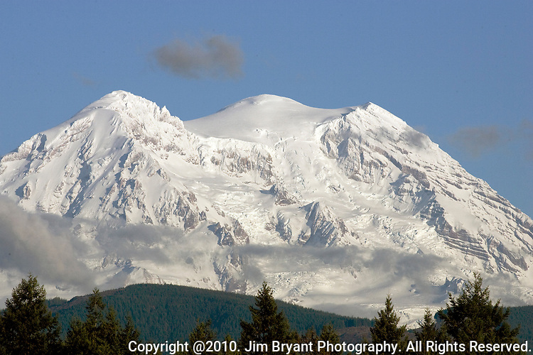 Many changes of weather on Mount Rainier.  Mt. Rainier is heavily glaciated, dormant volcano surrounded by alpine parks. The 14,411 foot volcano which covers 228,480 acres was designated a National Park in 1899. Jim Bryant Photo. &copy;2010. All Rights Reserved.