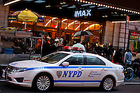 A NYPD car stands guard at the entrance of a theater during the 'Dark Knight Rises' movie premier after NYPD increased security at movie theaters in New York, July 20, 2012.  Photo by Eduardo Munoz Alvarez / VIEW.