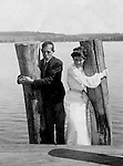 Lakewood NY: Young woman and Clark Stewart waiting for the City of Cleveland Ferry on the Kent House Pier - 1901. Photographs taken during a church field trip to Chautauqua Institution in New York (Lake Chautauqua). The Stewart family and friends visited Chautauqua during 1901 to hear Stewart relative, Dr. S.H. Clark  speak at the institute. Alice Brady Stewart chaperoned and Brady Stewart came along to photograph the trip.  The Gallery provides a glimpse of how the privileged and church faithful spent summers at Lake Chautauqua at the turn of the century.