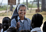 Sister Ninet D'Costa, FMA, a Catholic nun from India, is a teacher trainer in Malakal, Southern Sudan. Sister D'Costa came to the war-torn African country under the auspices of Solidarity with Southern Sudan, an international network of Catholic groups supporting Southern Sudan with educational personnel and prayer. Here Sister D'Costa greets students at a school in Detang, a small village across the Upper Nile River from Malakal.
