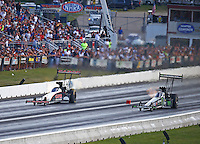 Jun 4, 2016; Epping , NH, USA; NHRA top fuel driver Steve Torrence (left) alongside Brittany Force during qualifying for the New England Nationals at New England Dragway. Mandatory Credit: Mark J. Rebilas-USA TODAY Sports