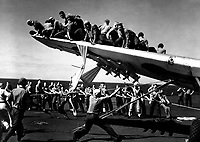 Crash of TBM #11, VC-69, in port catwalk of USS BOGUE.  #11 being raised from catwalk.  June 1944.  L.F. Cirzan.  (Navy)<br /> Exact Date Shot Unknown<br /> NARA FILE #:  080-G-266523<br /> WAR &amp; CONFLICT BOOK #:  965