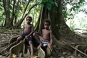 Young children in Bain village in the Cape Orford logging concession (run by Rimbunan Hijau- Malaysian logging giants), in Bain, East New Britain Island, Papua New Guinea,  Friday 19th September 2008.