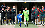 St Johnstone v Man Utd XI....31.07.10  Alan Main Testimonial.Alan Main pictured with his son Kristofer is applauded onto the pitch by Derek McInnes and Ole Gunnar Solksjaer.Picture by Graeme Hart..Copyright Perthshire Picture Agency.Tel: 01738 623350  Mobile: 07990 594431