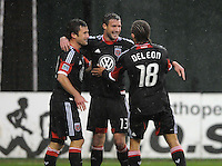 D.C. United midfielder Chris Pontius (13) celebrates with team mates Nick DeLeon (18) and Stephen King (20) his third goal in the 69th minute of the game.  D.C. United defeated The New York Red Bulls 4-1 at RFK Stadium, Sunday April 22, 2012.