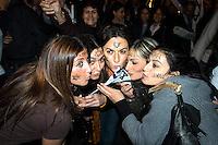 """Roma 3 Novembre 2005.Fiaccolata, davanti all'ambasciata iraniana di Roma, per diritto d'Israele all'esistenza, alla sicurezza e alla pace, contro le dichiarazioni antisemite del presidente iraniano Mahmoud Ahmadinejad, organizzata dal quotidiano """"Il Foglio""""  diretto da Giuliano Ferrara..Rome, November 3, 2005.Torchlight procession, in front of the Iranian Embassy in Rome, to the right of Israel to exist, for security and peace, against anti-Semitic statements by Iranian President Mahmoud Ahmadinejad organized by the newspaper """"Il Foglio"""" directed by Giuliano Ferrara. Girls with the Star of David and the word Israel drawn on  face, kissing the Girls with the Star of David and the word Israel drawn on  face, kissing the Israeli flag"""