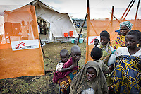 People outside the Medecins Sans Frontieres (MSF) tent in the Kibati camp for displaced people. MSF started a cholera treatment centre after cholera was diagnosed in the local health centre. Due to the new influx of displaced people after violence, Kibati camp is now overcrowded and the water and sanitation situation is deteriorating. An outbreak of cholera could be a further threat to many lives...
