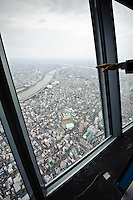 View from the Tokyo Sky Tree, Tokyo, Japan, October 30, 2011. Scheduled viewing platform to open to the public 22 March 2011, the Tokyo Sky Tree broadcasting tower is the tallest freestanding tower in the world at 634m high. On the 30 October 2011 the tower's 350m high viewing platform was opened to members of the media.