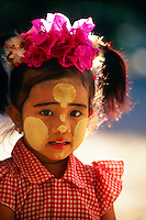 Little Burmese girl wearing thanaka-bark makeup, outside the Ananda Temple, Bagan, Myanamar (Burma)