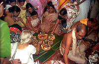 INDIA (West Bengal - Calcutta)  2006, Women family members of Mullick family (one of the well known families in South Calcutta) lit up 108 lamps on the occassion of Sandhi Puja during Durga Puja. Sandhi Puja(Puja =  worship of god) happens on the precise moment when the Durga idol comes alive according to the hindu belief.  Durga Puja Festival is the biggest festival among bengalies.  As Calcutta is the capital of West Bengal and cultural hub of  the bengali community Durga puja is held with the maximum pomp and vigour. Ritualistic worship, food, drink, new clothes, visiting friends and relatives places and merryment is a part of it. In this festival the hindus worship a ten handed godess riding on a lion armed wth all possible deadly ancient weapons along with her 4 children (Ganesha - God for sucess, Saraswati - Goddess for arts and education, Laxmi - Goddess of wealth and prosperity, Kartikeya - The god of manly hood and beauty). Durga is symbolised as the women power in Indian Mythology.  In Calcutta people from all the religions enjoy these four days of festival in the moth of October. Now the religious festival has become the biggest cultural extravagenza of Calcutta the cultural capital of India. Artistry and craftsmanship can be seen in different sizes and shapes in form of the idol, the interior decor and as well as the pandals erected on the streets, roads and  parks.- Arindam Mukherjee