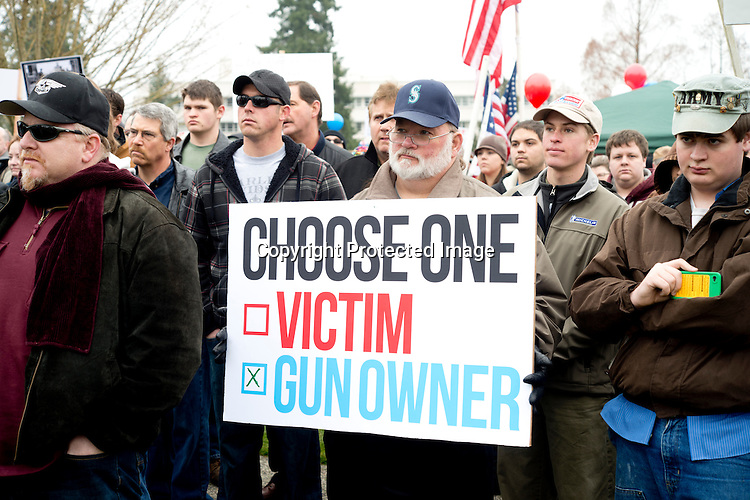 About 1,500 gun owners and supporters attended the Guns Across America rally at the Washington State Capitol in Olympia Saturday, Jan. 19, 2013. The organization held events at every state capitol building to show support for the 2nd Amendment and opposition to new gun control measures. Photo by Daniel Berman/www.bermanphotos.com.
