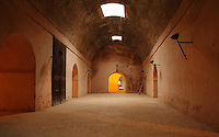 Heri es-Souani, granaries for storing grain and hay, built in the 17th century under Sultan Moulay Ismail Ibn Sharif, 1672-1727, Alaouite dynasty, at Meknes, Meknes-Tafilalet, Morocco. The building has tiny windows, massive walls and a system of underground water channels, which keep the air cool and circulating. Much of the building is now in ruins, although some of the vaults have been restored. Picture by Manuel Cohen