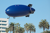 Kevin Cororan from GOBLIMPS.COM retrieves his float Santa Monica Beach on Saturday, November 13, 2010.