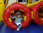 TORRINGTON, CT 01/01/09- 010209BZ03- Abigail Foulds, 2, of Torrington, climbs out of an inflatable obstacle course during &quot;last night&quot;activities at the Torrington Armory Friday night.   The event, a celebration usually held on New Year's Eve, was rescheduled due to inclement weather.<br /> Jamison C. Bazinet Republican-American