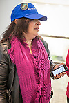 """Melville, New York, USA. 24th January 2017. ANDREA ROSS BOYLE, of Dix Hills, is wearing a """"WE'RE STILL HERE"""" blue cap with large button that has picture of Statue of Liberty and says """"WOMEN'S MARCH in New York City, January 21, 2017"""" on it. She's one of 15 members of Together We Will Long Island that stopped by to visit Melville office of U.S. Senator Chuck Schumer of New York, to share their concerns, especially about Trump's Cabinet appointees, #SwampCabinet. Her cell phone shows web page with info about a Volunteer Orientation meeting at Hofstra University that night. This Stop Trump Tuesday, #StopTrumpTuesday, event was part of nationwide political movement.  Members of organizations such as MoveOn, Indivisible, and TWW plan to visit their Senators' offices each Tuesday duringTrump's first 100 days of presidency."""