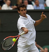 Marin Cilic (CRO) (11) against  Sam Querrey (USA) in the second round of the gentlemen's singles. Cilic beat Querrey 4-6 7-6 6-3 6-7 6-4..Tennis - Wimbledon - Day 3 - Wed  24th June 2009 - All England Lawn Tennis Club  - Wimbledon - London - United Kingdom..Frey Images, Barry House, 20-22 Worple Road, London, SW19 4DH.Tel - +44 20 8947 0100.Cell - +44 7843 383 012