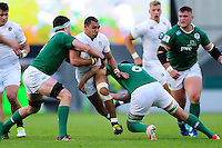 Joe Marchant of England U20 takes on the Ireland U20 defence. World Rugby U20 Championship Final between England U20 and Ireland U20 on June 25, 2016 at the AJ Bell Stadium in Manchester, England. Photo by: Patrick Khachfe / Onside Images