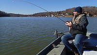 NWA Democrat-Gazette/FLIP PUTTHOFF<br /> Jon Stein, fisheries biologist with the Arkansas Game and Fish Commission, has a fish on the line Dec. 4, 2015 while trolling a lure in the Monte Ne area of Beaver Lake.