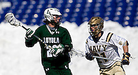 Stephen Murray (26) of Loyola is defended by Joe McAuliffe (21) of Navy at the Navy-Marine Corp Memorial Stadium in Annapolis, Maryland.   Loyola defeated Navy, 8-7, in overtime.