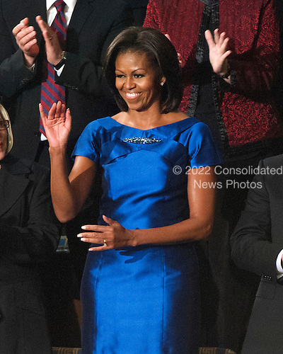 First lady Michelle Obama waves as she arrives for United States President Barack Obama's State of the Union Address to a Joint Session of Congress in the U.S. Capitol in Washington, D.C., Tuesday, January 24, 2012..Credit: Ron Sachs / CNP
