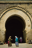 Meknes, Morocco.  Bab Dar El-Kebira, one of several entrances into the imperial residential quarter.  Note how the decorative tiles have fallen off the upper right quadrant above the arch.