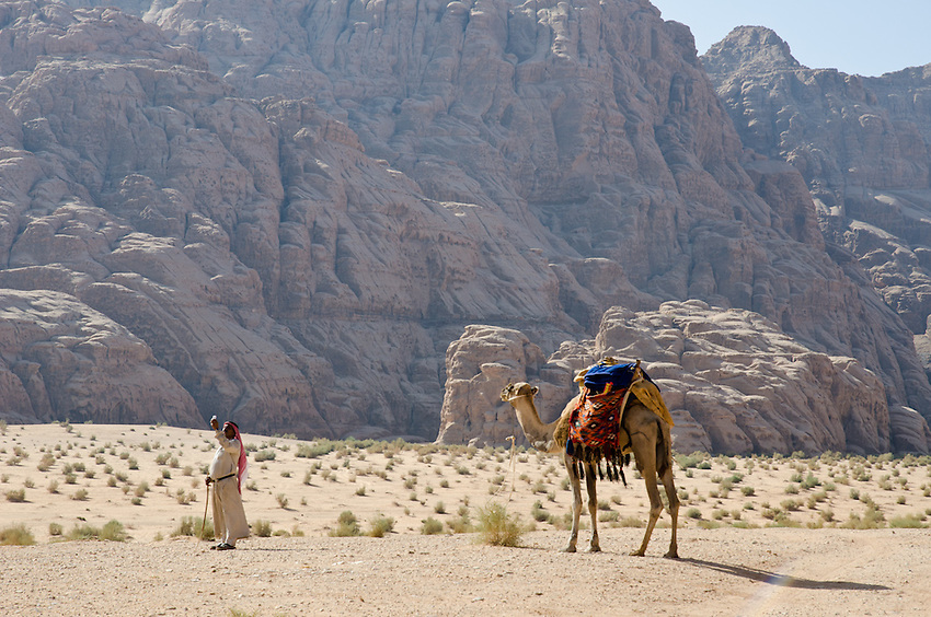 A Bedouin guide tries to find a mobile phone signal deep in the desert at Wadi Rum, Jordan. Many Bedouins here have left their lives as herders and turned to tourism for their livelihoods.