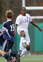 HYATTSVILLE, MD - OCTOBER 26, 2012:  Alfonce Mutuku (14) of DeMatha Catholic High School knocks the ball away from Nate Johnson (19) of St. Albans during a match at Heurich Field in Hyattsville, MD. on October 26. DeMatha won 2-0.