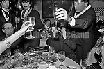 December 31, 1986:   Andy Warhol's snaps a photo as friends raise a glass to toast the New Year as Andy celebrates his last New Year's Eve with a dinner at Cafe Roma restaurant in New York City, New York.  Warhol died less than two months later on February 22, 1987..