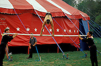 "circus acrobats practice in ""back yard"". Bentley Bros. circus, one of the few remaining ""mud show"" circus performing under a canvas big top."