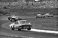 """Sam Posey gets the inside wheels off the ground while driving his BMW 3.0 CSL through the """"Big Bend"""" corner during the Schaefer 350 IMSA Camel GT race at Lime Rock Park near Lakeville, Connecticut, on May 26, 1975. (Photo by Bob Harmeyer)"""